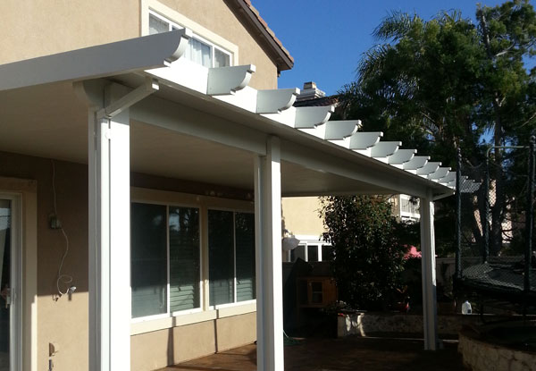 This Attached Patio Cover Installation In Chula Vista, CA Includes Beam,  Wrapped Posts, A Wrapped Fascia, And Corbel Cut End Tails.
